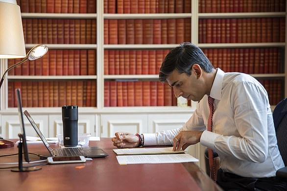 Rishi Sunak's mug (pictured on his desk, black) is a £180 expensive travel mug