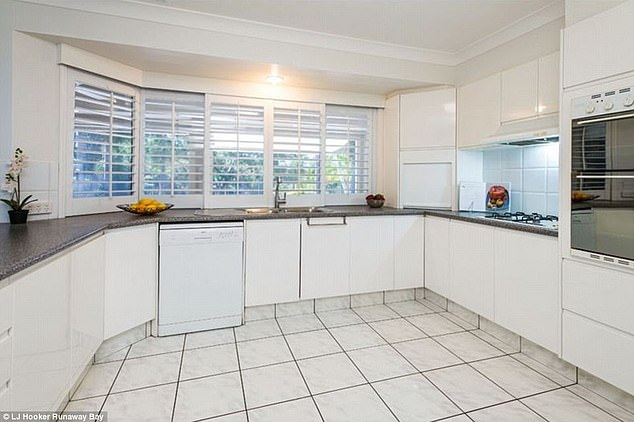 Modern: Inside the Helensvale property is an all-white kitchen, featuring marble bench-tops and tiled floors
