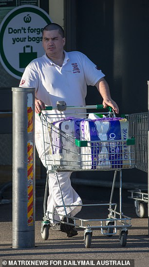Pictured: A man with toilet paper in Melbourne on Tuesday