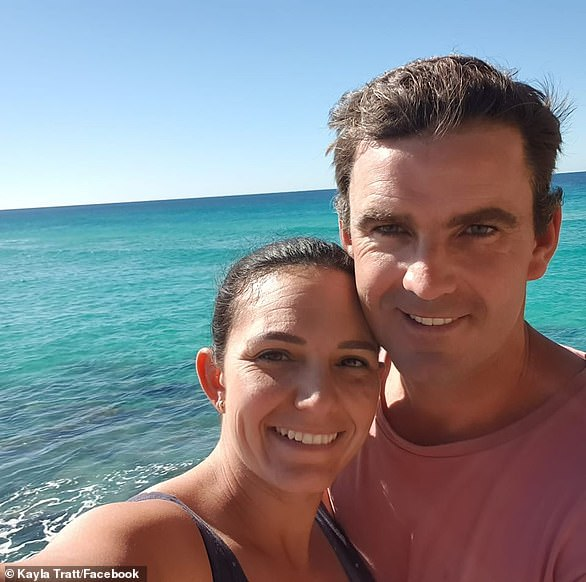 Matthew Tratt (right), 36, was attacked by a by a suspected great white shark at Fraser Island on Saturday afternoon while spear fishing with his brother. Pictured with his wife Kayla