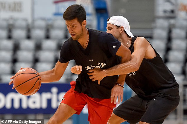 They also played basketball - Grigor Dimitrov (right) was one who tested positive for Covid-19