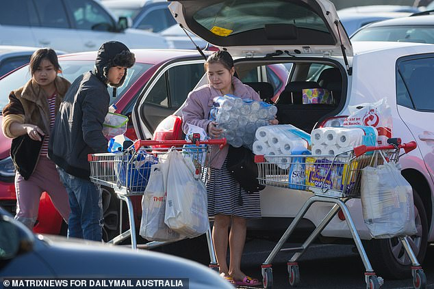 Daily Mail Australia watched the shoppers visit one supermarket, load up, and then do the same at another
