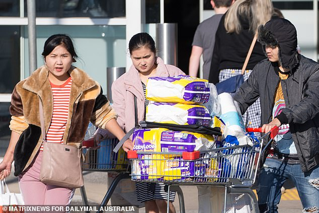 A family of shoppers were spotted buying up essentials at supermarkets in Melbourne's western suburbs