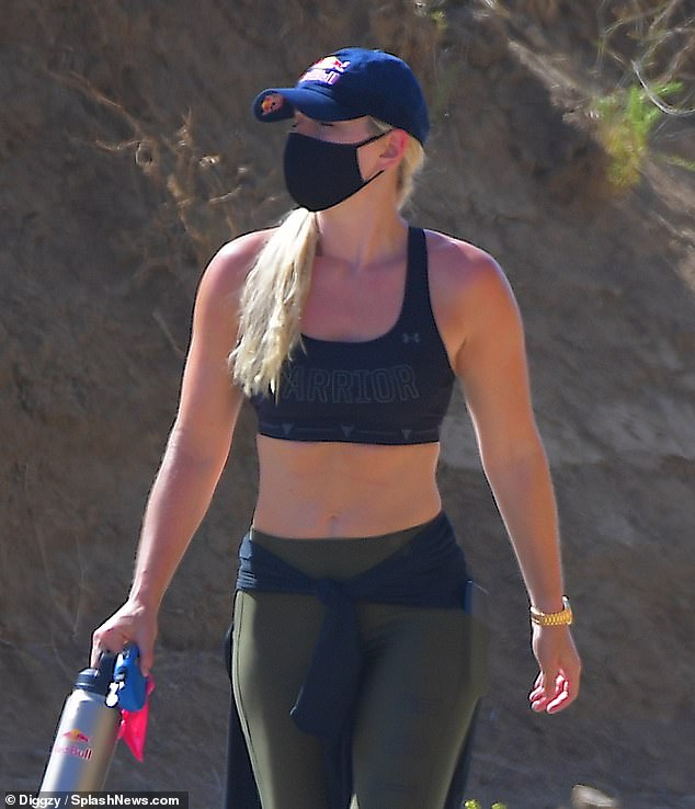 Abs-olutely fabulous: The 35-year-old former World Cup alpine ski racer showcased her toned tummy in an Under Armour crop top