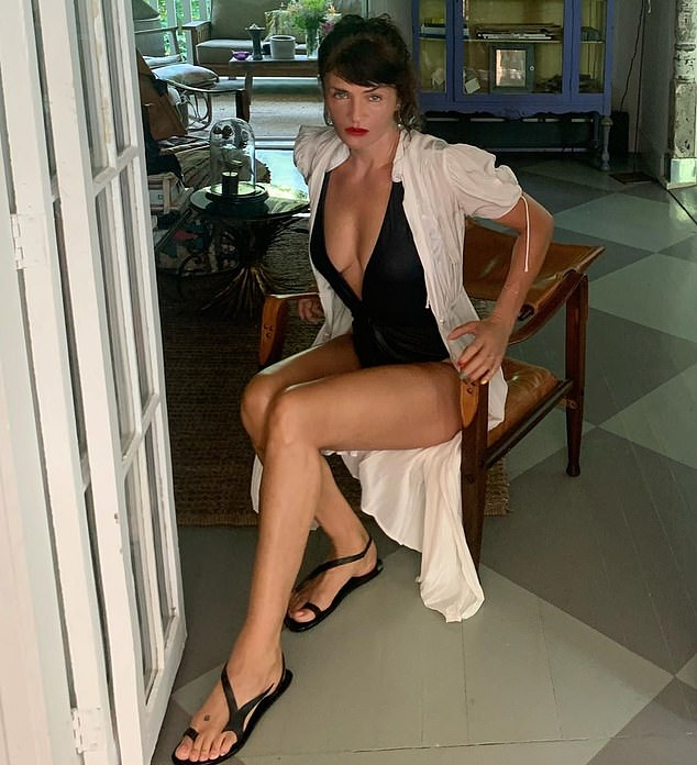 Supermodel Helena Christensen in the picture she posted of herselfsporting a £357 black swimsuit she designed for Staerk & Christensen