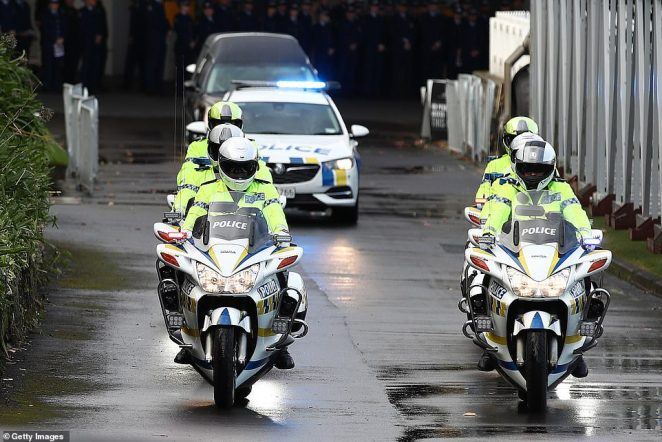 A police motorcade with motorbikes and police cars led the hearse away after Mr Hunt's funeral at Eden Park
