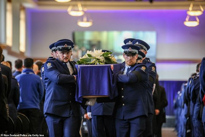 Mr Hunt's coffin was decorated with white lilies and a police flag and carried by some of his closest friends