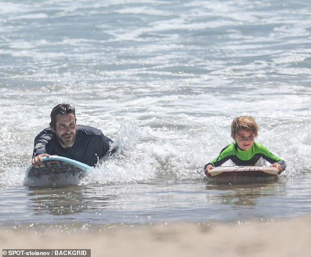 Weeee! Oscar winner Christian Bale bodyboarded with his cute son Joseph - turning 6 next month - during their family beach day in Malibu on Wednesday