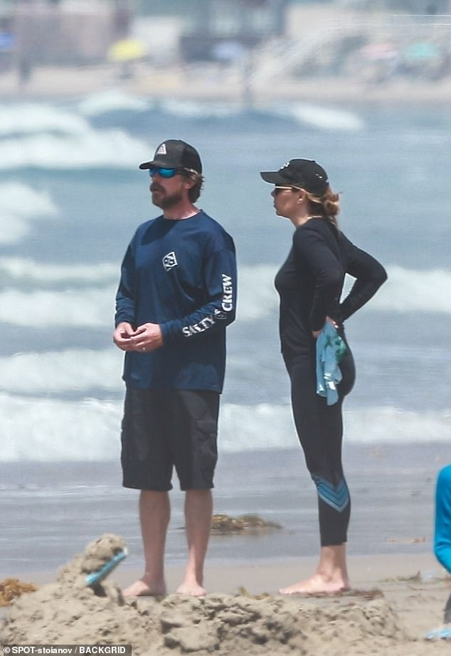 Ignoring CA mask mandate: Christian was joined on the sand by his wife of 20 years, stuntwoman Sibi Blažic, and their 15-year-old daughter Emmeline (not pictured)