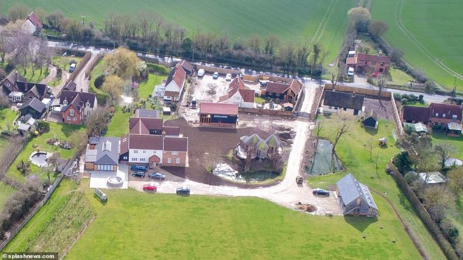 Sheeranville: Reports from the area have claimed the pop star, 29, wants to secure three homes on the outskirts of his £3.7 million estate because their gardens encroach on his land
