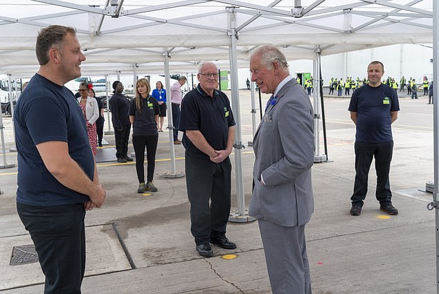 The couple met some of the 700 workers at the Asda centre, as well as drivers and those based at nearby stores. Pictured, Prince Charles