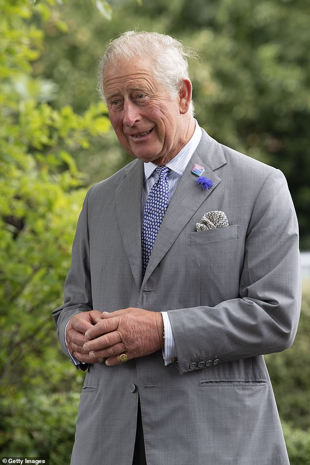 Speaking to staff at the shirt factory who helped to make scrubs amid the global crisis, Prince Charles (pictured) said: 'it made such a difference to the local GP as I managed to put them in touch with your beautifully made scrubs'
