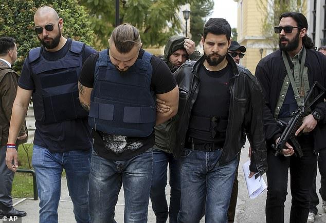 Macris was killed by Bulgarian brothers Yuliyanov J Raychev Serafim (pictured centre) and Milen Raychev in October 2018