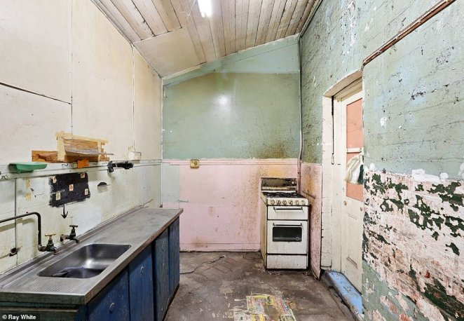 The kitchen will need a total overhaul to fix the peeling paint job and unfinished interior complete with new floorboards or tiles