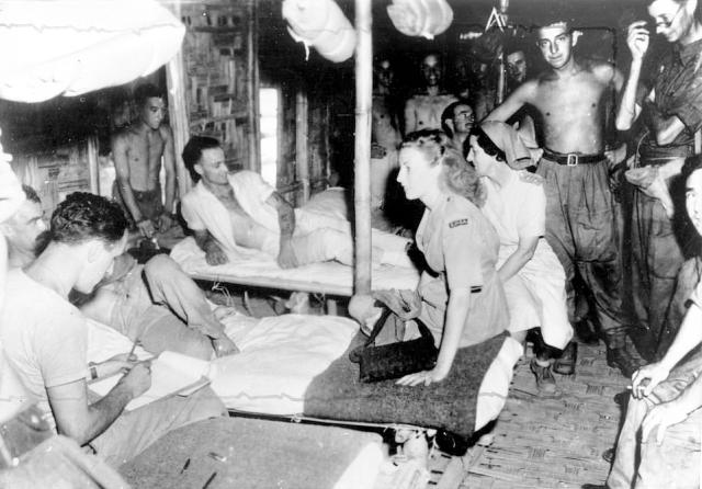 Vera Lynn with British servicemen in World War II in Burma in 1942 as she risked her own life to be by their side and perform for them