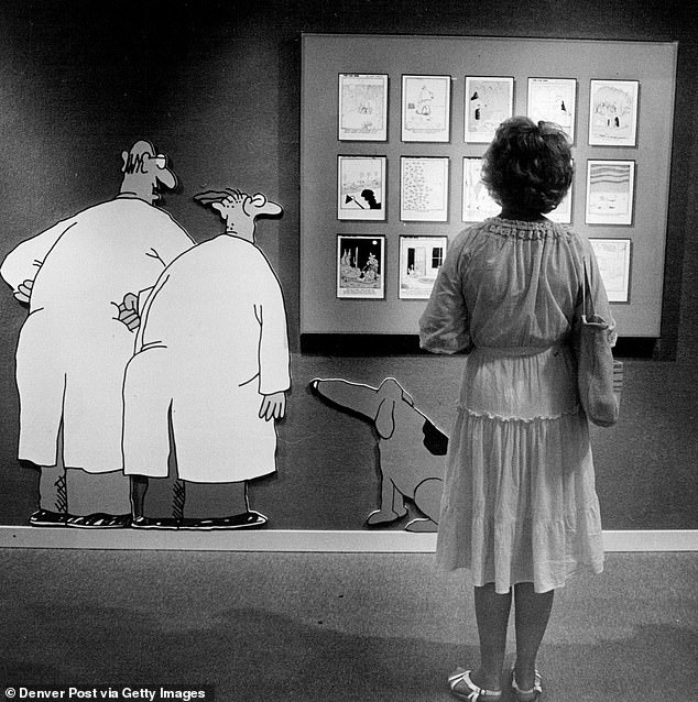 Larson's work with The Far Side has featured in nearly 2,000 newspapers and 40 million books across the world. Pictured, his cartoons at the Museum of Natural History in New York