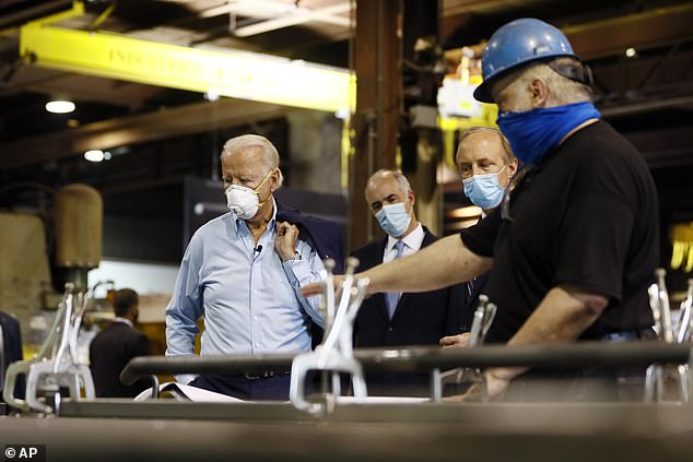 President Trump is trying to tie Joe Biden, seen during a factory visit in Pa. on Thursday, to the left wing of the party