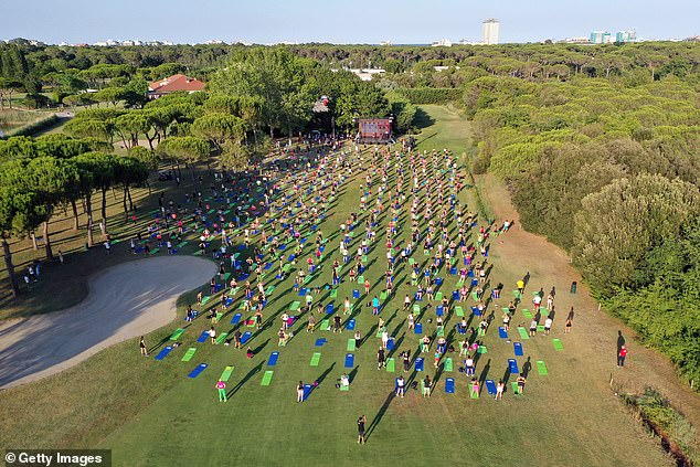 Mass workout: Snaps show the many exercisers socially distancing across a park as they all took part in the workout