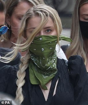 Amber Heard was pictured leaving the Royal Courts of Justice while wearing the green face covering with a strikingly similar pattern to that of her sister's earlier today in London
