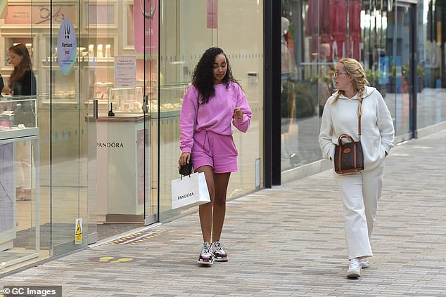 Chatting away: The two women appeared deep in conversation as they ambled along