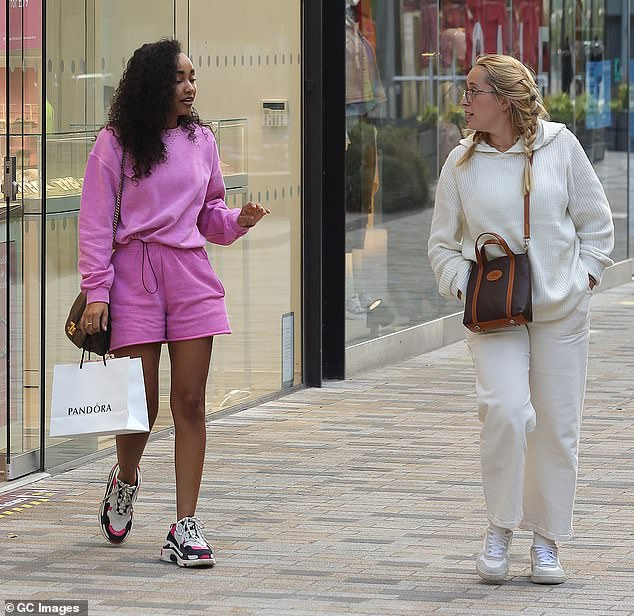 Looking good! Leigh-Anne's pal looked stylish in a white tracksuit and trainers