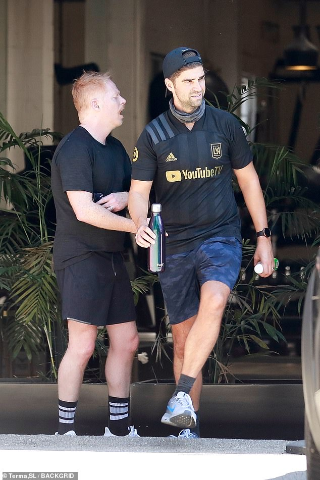 Paired:The first time fathers donned matching all black outfits for their exercise time