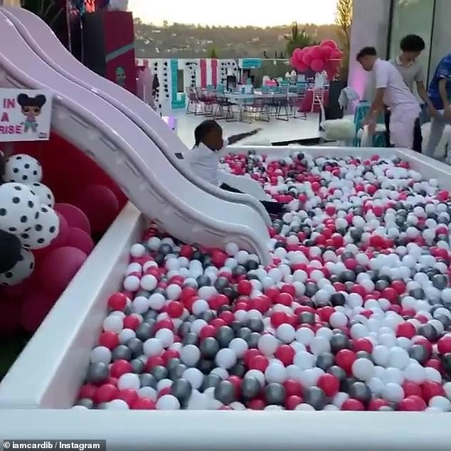 A kid's dream:Cardi posted multiple videos to her Instagram Story that revealed a massive ball pit set up outside that kids in attendance could slide into