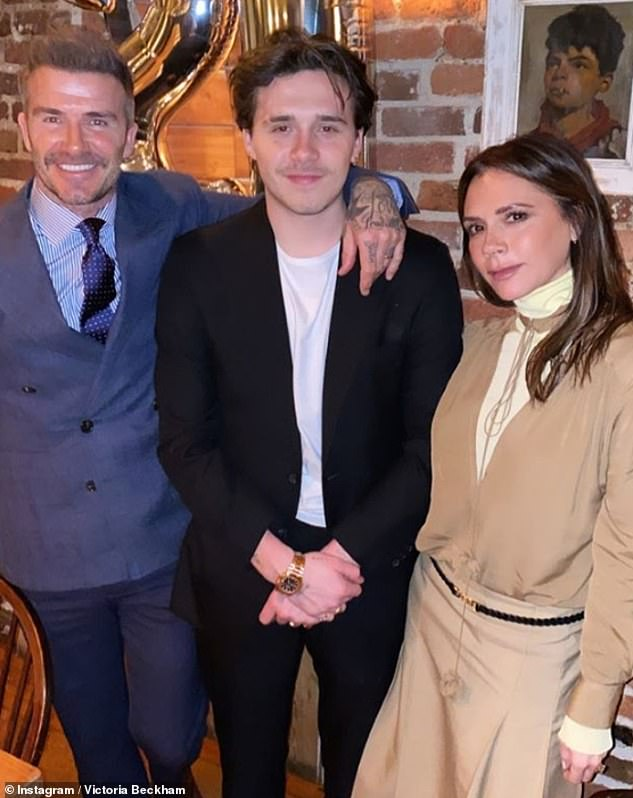 Over the moon: The family flooded social media with proud posts mere minutes after Brooklyn revealed he'd popped the question (David and Victoria pictured with Brooklyn in March)