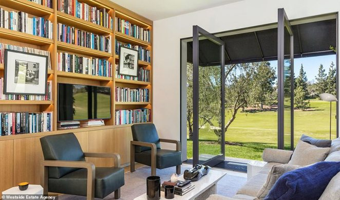 Room with a view: A small reading room is perfect for residents to spent an afternoon snuggled underneath blankets or walk through glass doors that open into the backyard