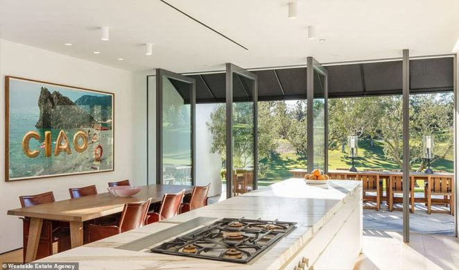 Dining: The family spent meals at a beautiful dining room table with an expansive kitchen