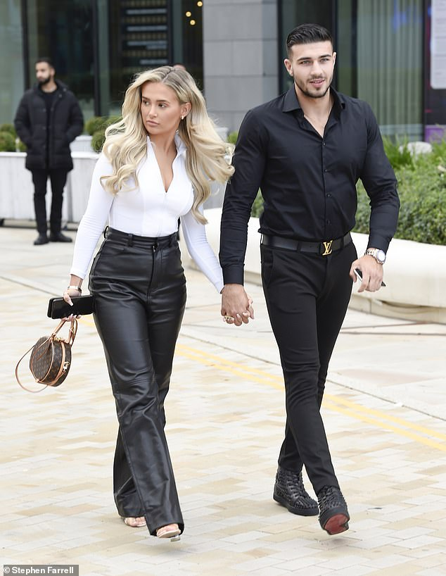 Monochrome: The couple were clad inclad in coordinating black and white attire, with Molly adding a flash of white with a figure-hugging bodysuit
