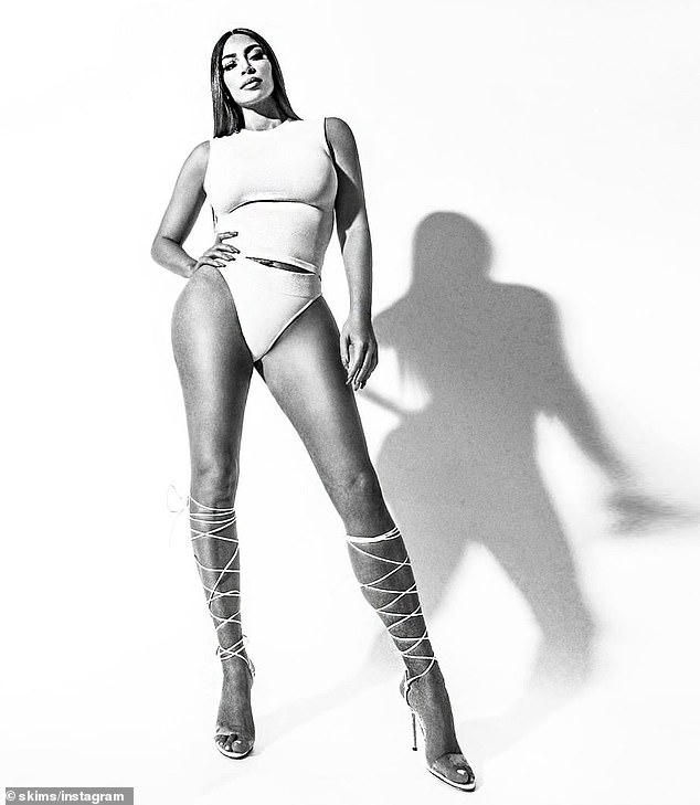 Leggy display: Kim Kardashian looked impossibly long-limbed, as she showcased her phenomenal figure in a pair of white underwear and leg-wrapping sandals sandals
