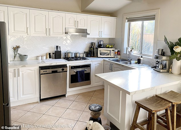 AFTER:But, after getting permission from her landlord, Nicole said she managed to transform her dated wooden kitchen into a modern, sleek space in just six weekends - spending $953