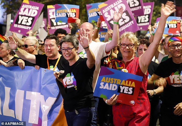 Labor MP Penny Wong (centre left) takes part in the 40th annual Gay and Lesbian Mardi Gras parade in Sydney in 2018