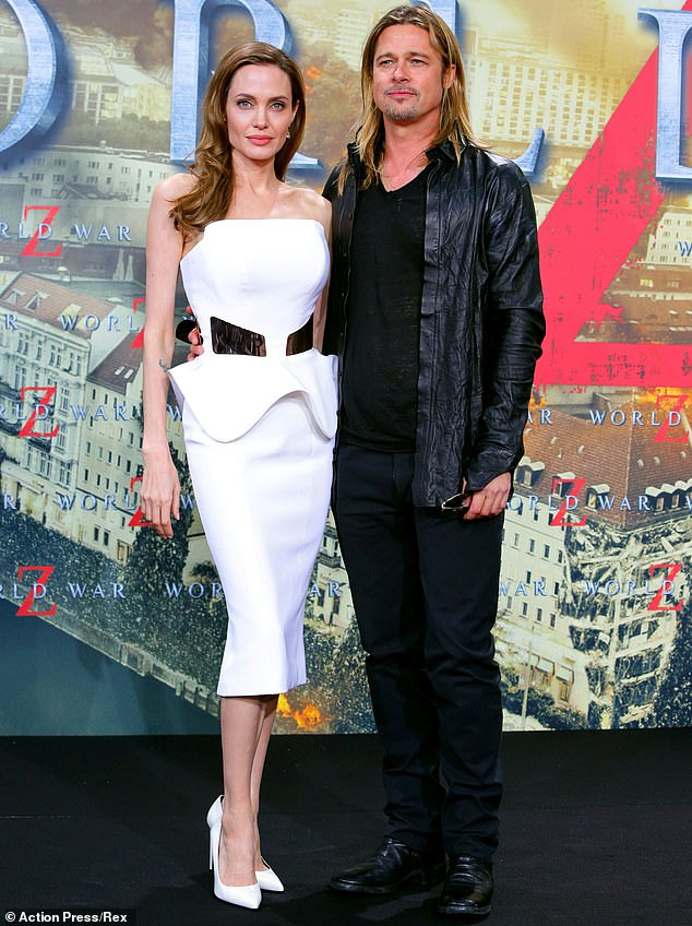The way they were: Brad and Angelina are pictured at the World War Z premiere in Berlin in 2013, one year before they got married