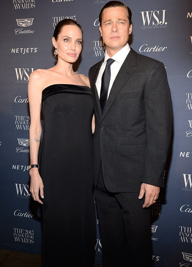 Side by side:Brad Pitt and Angelina Jolie's divorce proceedings are allegedly being held up because of the coronavirus pandemic; pictured in 2015