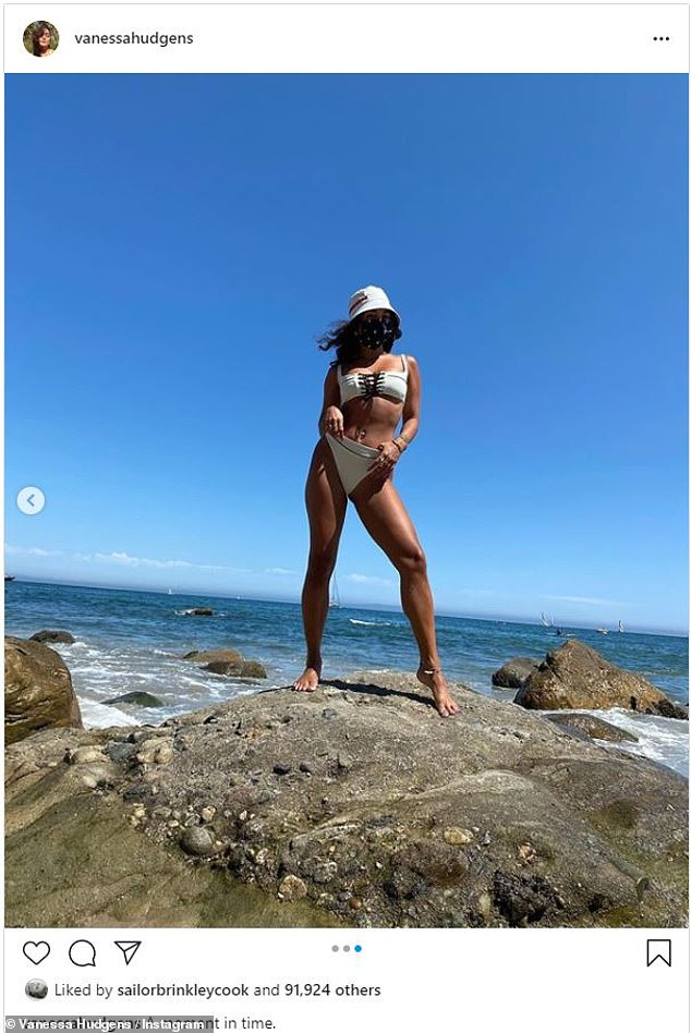 Safely soaking up the sun! Vanessa Hudgens shared snaps of herself rocking a sexy swimsuit and stylish face mask at the beach on Saturday