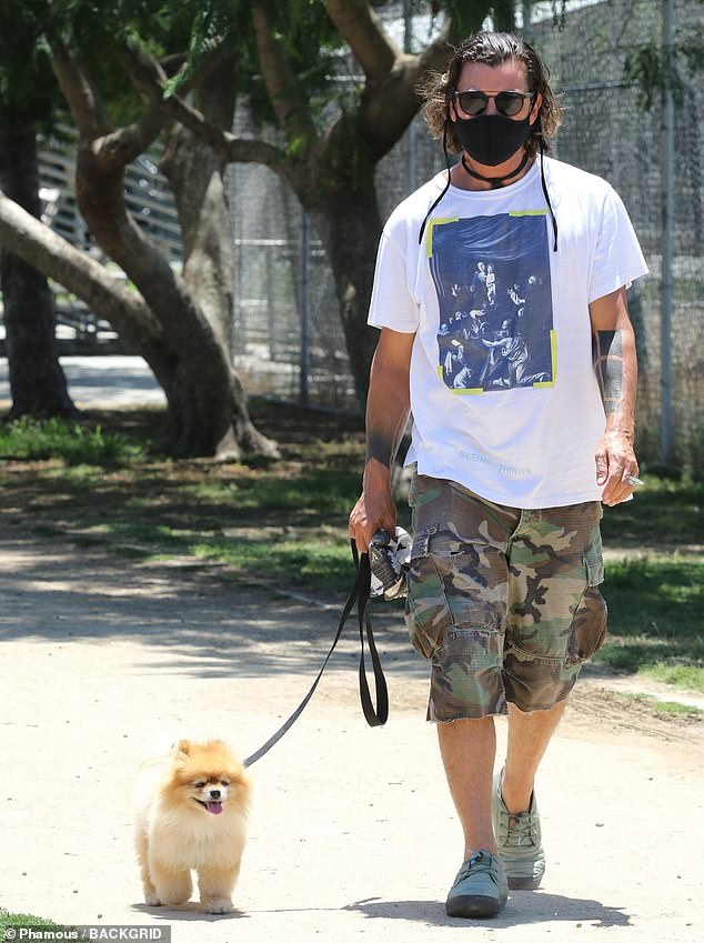 Incognito mode:Rossdale kept the majority of his famous face hidden behind his mask and a pair of sunglasses as he ventured around with his leashed pup