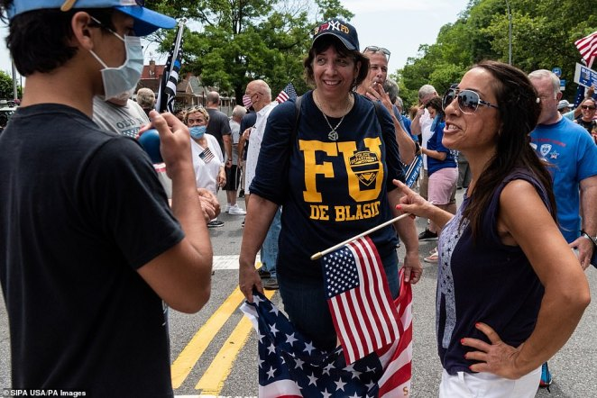 A woman wears a t-shirt denouncing Mayor Bill de Blasioduring a Blue Lives Matter rally in Bay Ridge, Brooklyn, on Saturday