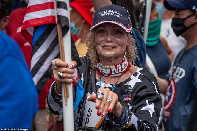 One woman wears paraphernalia in praise of President Trumpduring a Blue Lives Matter rally in Bay Ridge, Brooklyn, on Saturday