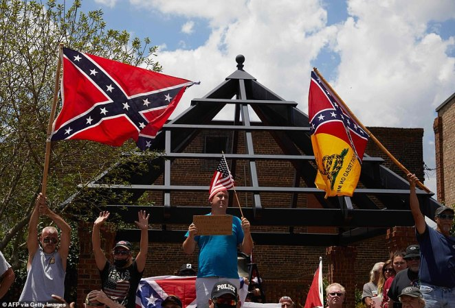 Supporters of the Confederacy and the Confederate monument at the Alamance County Courthouse yell at protesters from the Burlington-Alamance March For Justice and Community that marched to hold a rally in front of a Confederate monument in Graham