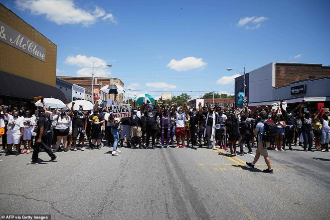 Some 300 people carrying signs that read 'Black Lives Matter' turned out in Graham, North Carolina, on Saturday