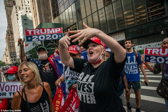 Supporters of President Trump gesture toward opponentsduring a demonstration in front of Trump Tower in New York City on Saturday
