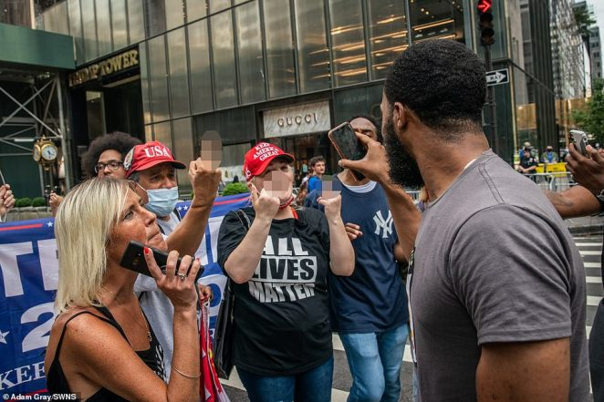 Supporters and opponents of President Trump argue and make angry gestures in front of Trump Tower in New York City on Saturday