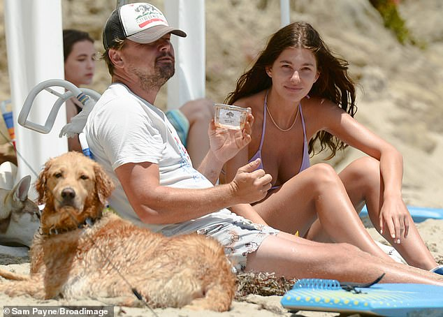 Romantic outing: Leonardo DiCaprio sported a beach bum look Saturday as he was spotted at the beach in Malibu with girlfriend Camila Morrone and his dog, during a break from quarantine