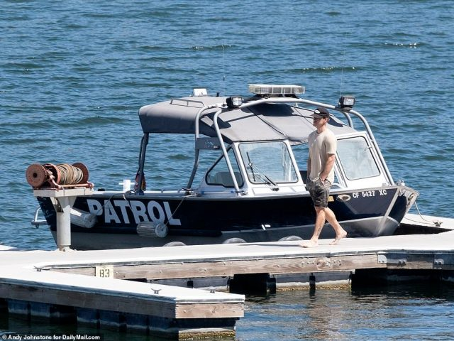 Dorsey, 36, would be seen walking along the docks close to patrol boats at the side of the lake