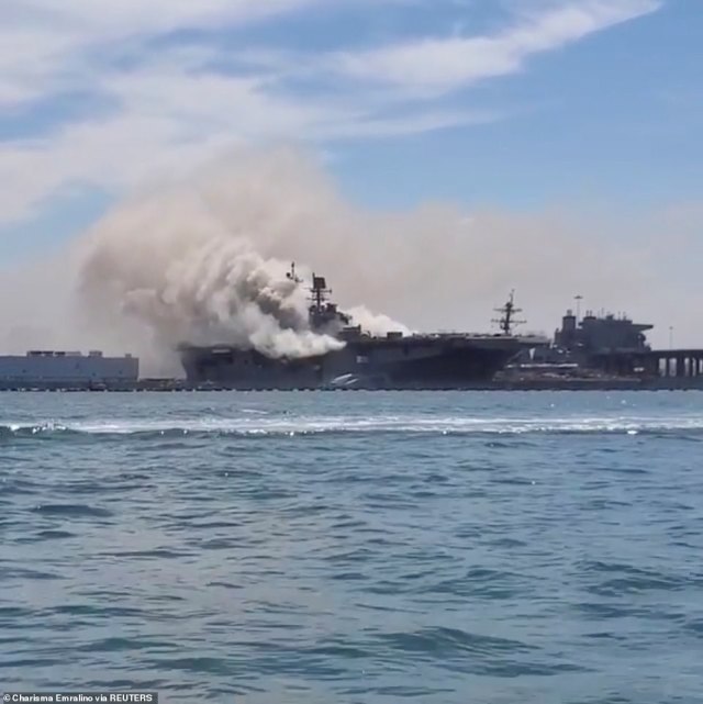 A view of the smoking naval ship above. It's unclear what sparked the fire and explosion