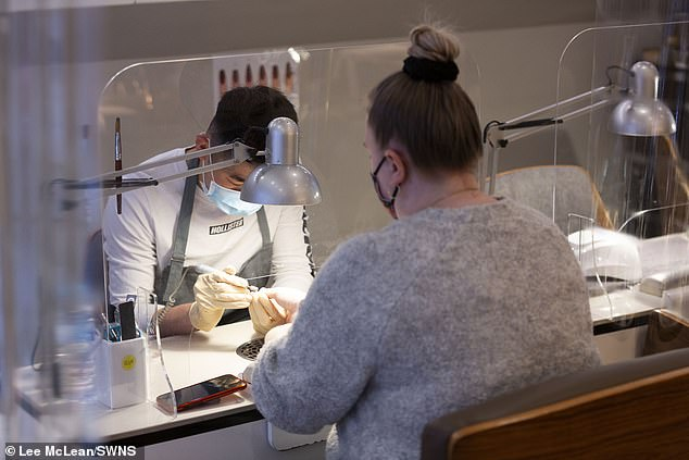The first customers get their nails done in Leeds city centre today