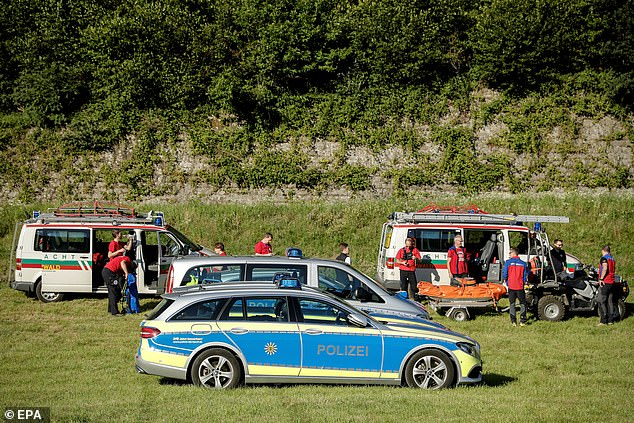 Police in Oppenau warned local residents to stay at home and not pick up any hitchhikers. Pictured: Emergency vehicles at the scene