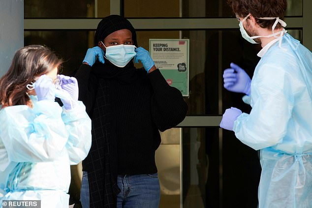 A resident with health workers outside a public housing tower in Melbourne on July 10